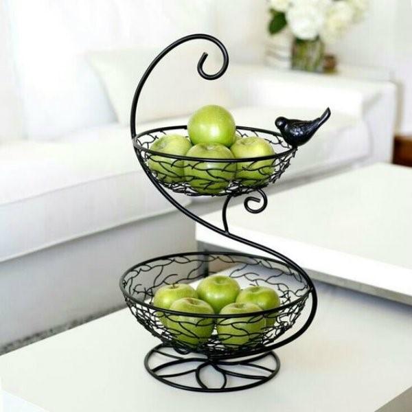 6 A fruteira ganha vida com um pássaro integrado.