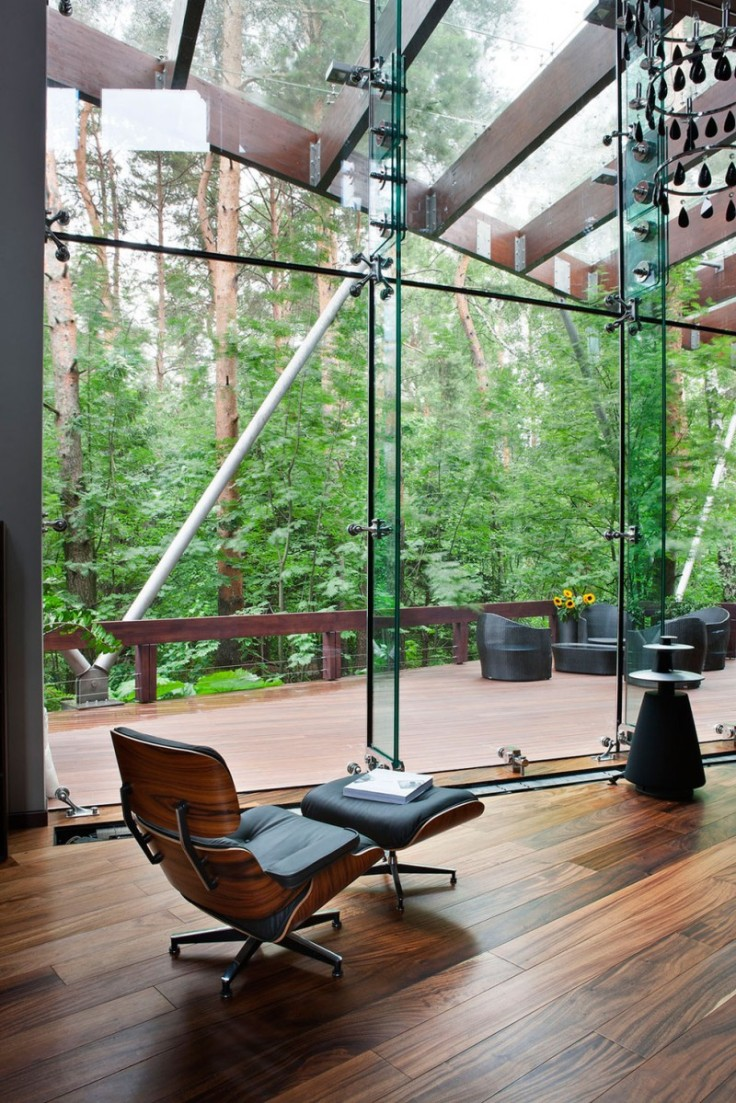 Eames lounge chair Contemporary house Wooden floor Glass wall